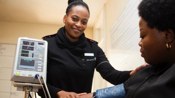 nurse-taking-patient-blood-pressure-smiling