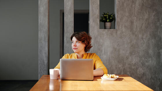 photo-of-woman-sitting-by-the-table-while-looking-away-4064645